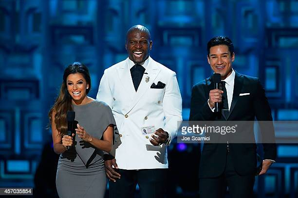 Host Eva Longoria actor Terry Crews and Mario Lopez speak onstage during the 2014 NCLR ALMA Awards at Pasadena Civic Auditorium on October 10 2014 in...