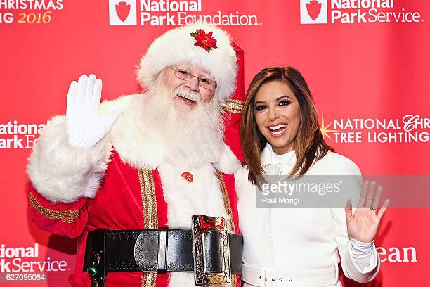 Host Eva Longoria poses for a photo with Santa Claus backstage at the 94th Annual National Christmas Tree Lighting Ceremony on the Ellipse in...