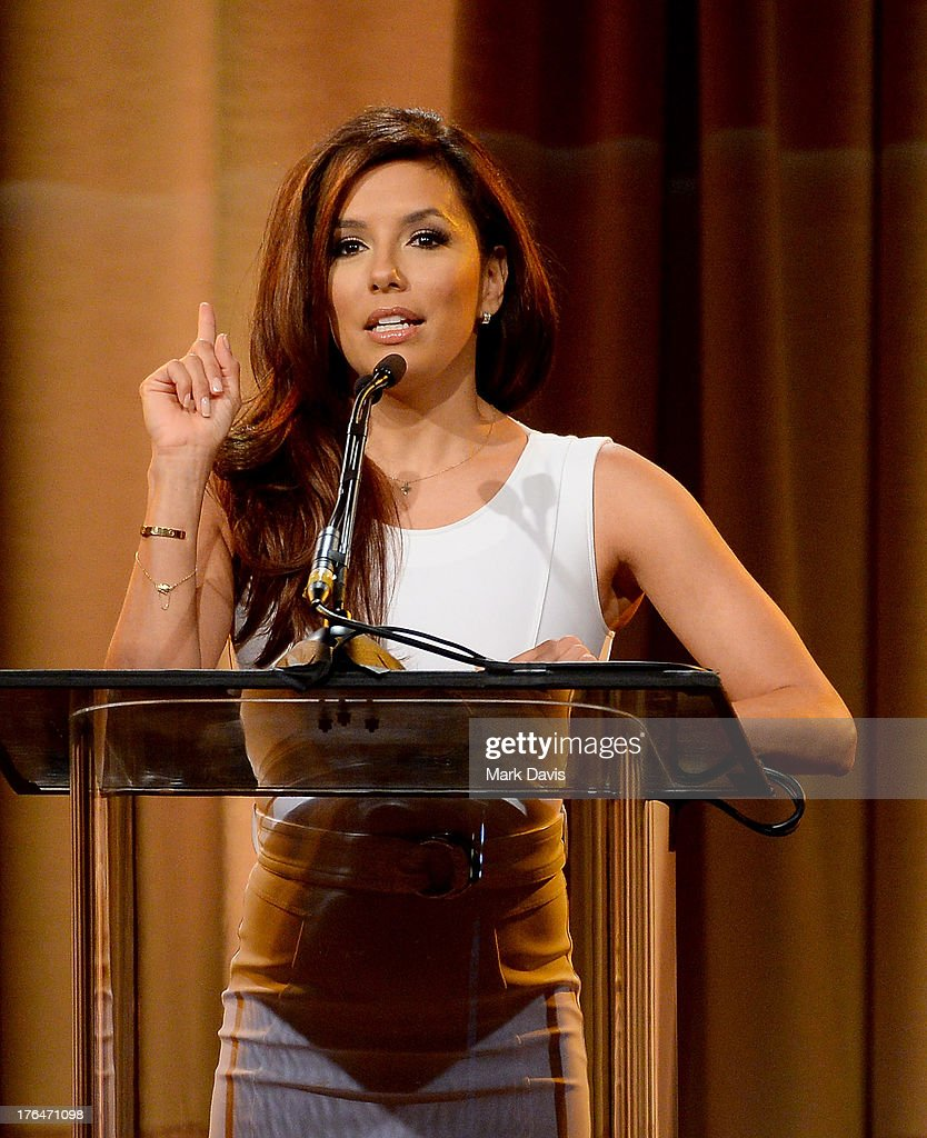 Host Eva Longoria speaks onstage at the Hollywood Foreign Press Association's 2013 Installation Luncheon at The Beverly Hilton Hotel on August 13, 2013 in Beverly Hills, California.