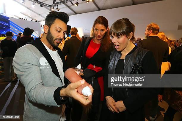 A host explains Quickcap to Anneke Kim Sarnau and a friend during the MercedesBenz Fashion Week Berlin Autumn/Winter 2016 at Brandenburg Gate on...