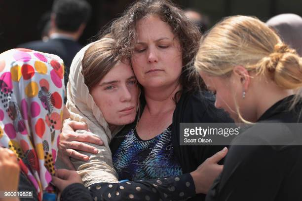 Host family members of Sabika Sheikh are comforted following a funeral prayer service at the Brand Lane Islamic Center on May 20 2018 in Stafford...