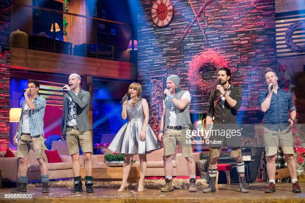 Host Francine Jordi and Band 'Voxxclub' perform during the New Year's Eve tv show hosted by Joerg Pilawa on December 30 2017 in Graz Austria