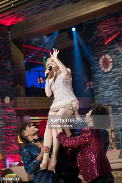 Host Francine Jordi performs during the New Year's Eve tv show hosted by Joerg Pilawa on December 30 2017 in Graz Austria