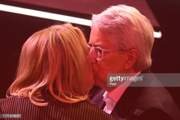 TV host Frank Elstner kisses his wife Britta Gessler after receiving the 'Best Newcomer' award during the YouTube Goldene Kamera Digital Awards at...
