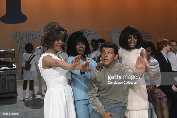 Host Frankie Avalon joins singers Mary Wilson Florence Ballard and Diana Ross of the R and B Group 'The Supremes' as they rehearse for their...