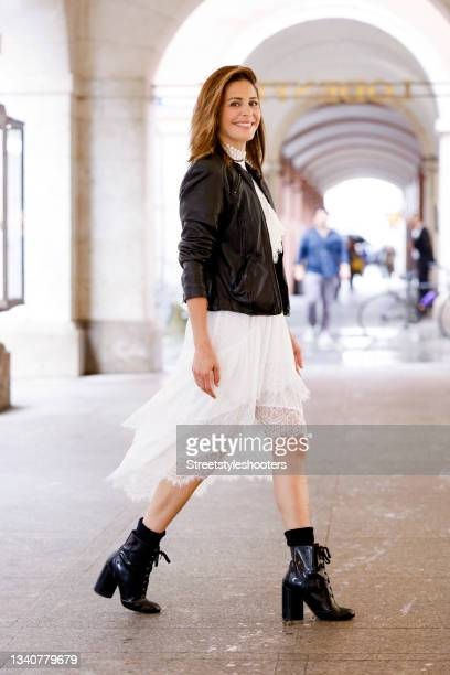 Host Funda Vanroy, wearing a white lace dress by The Kooples, a black leather jacket by Liebeskind and black boots by Marc Jacobs, seen at the Viky...