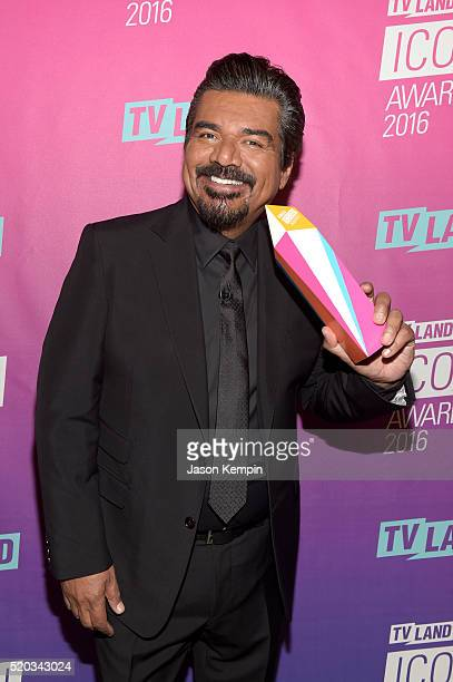 Host Geoge Lopez poses with an award backstage at 2016 TV Land Icon Awards at The Barker Hanger on April 10 2016 in Santa Monica California