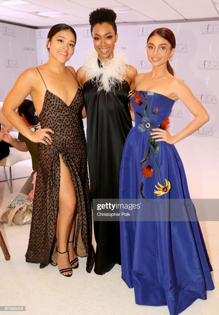 Host Gina Rodriguez, actor Sonequa Martin-Green, and actor Sarah Hyland attend the Costume Designers Guild Awards at The Beverly Hilton Hotel on February 20, 2018 in Beverly Hills, California.