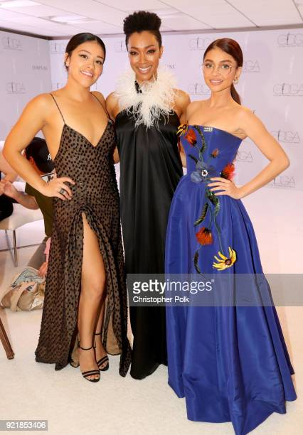 Host Gina Rodriguez actor Sonequa MartinGreen and actor Sarah Hyland attend the Costume Designers Guild Awards at The Beverly Hilton Hotel on...