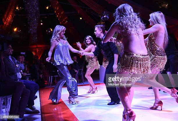 Host Goldie Hawn and dancer Derek Hough attend Goldie Hawn's inaugural Love In For Kids benefiting the Hawn Foundation's MindUp program transforming...