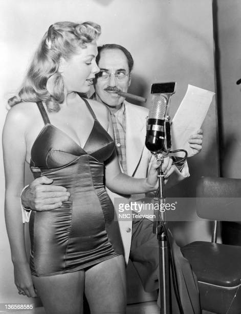 Host Groucho Marx with a contestant on the TV quiz show 'You Bet Your Life' 1952