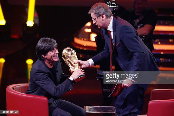 TV host Guenther Jauch hands over the World Cup to Joachim Loew Head coach of German national football team during the 2014 Menschen Bilder Emotionen...