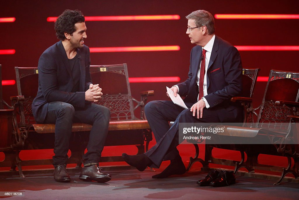 TV host Guenther Jauch (R) interviews without his shoes Elyas M'Barek during the 2014! Menschen, Bilder, Emotionen - RTL Jahresrueckblick show on December 7, 2014 in Cologne, Germany.