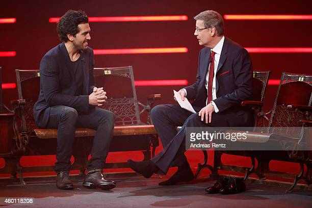TV host Guenther Jauch interviews without his shoes Elyas M'Barek during the 2014 Menschen Bilder Emotionen RTL Jahresrueckblick show on December 7...