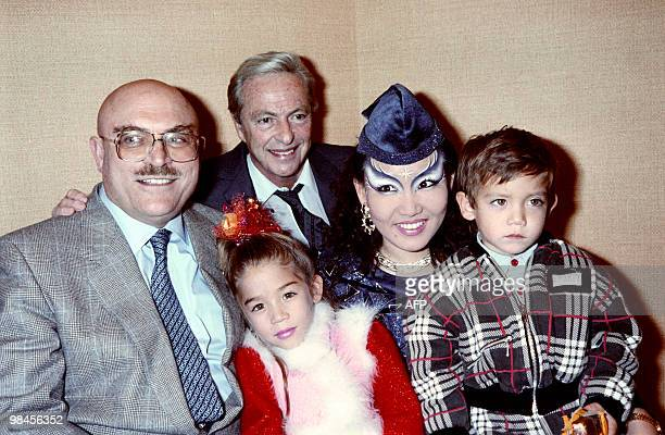 TV host Guy Lux poses with Raymond Nakachian a wealthy Lebanese businessman and husband of Korean singer Kimera and their children Melodie Nakachian...