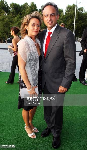 Host Hansi Mueller Poses With His Wife Prior To Hansi