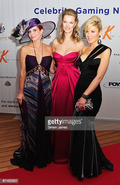 Host Helena Houdova Hofit Golan and Phoebe Price attend the Wilhelm Karl Maybach Foundation Gaming Night at the Hotel Du Cap during the 62nd...