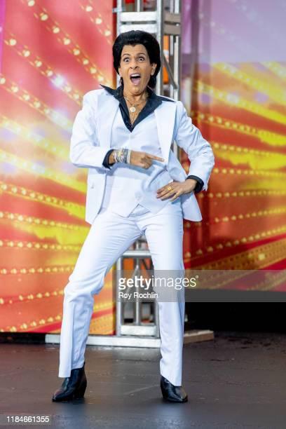 "Host Hoda Kotb dressed as Tony Manero of ""Saturday Night Fever"" during NBC's ""Today"" Halloween Celebration at Rockefeller Plaza on October 31, 2019..."