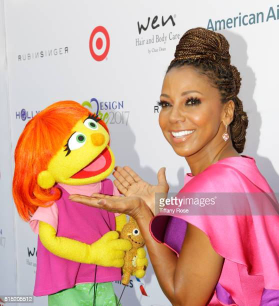 Host Holly Robinson Peete and the first autistic Sesame Street character Julia at HollyRod Foundation's DesignCare Gala on July 15 2017 in Pacific...