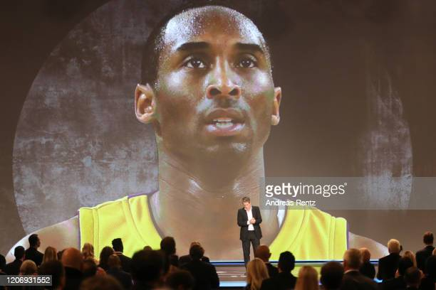 Host Hugh Grant asks for applause to commemorate late Kobe Bryant during the 2020 Laureus World Sports Awards at Verti Music Hall on February 17,...