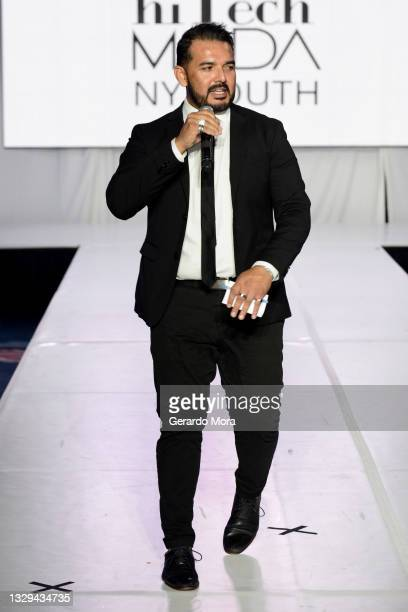 Host J. Vladimir speaks on the runway for Moody and Co Leather during Orlando Swim Week Powered By hiTechMODA on July 18, 2021 in Orlando, Florida.