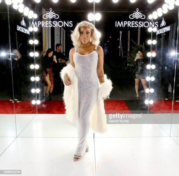Host Jackie Aina @jackieaina attends the Impressions Vanity Company Naughty or Nice holiday celebration at Nightingale Plaza on December 5 2018 in...