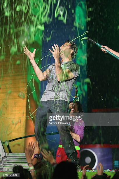 Host Jaime Camil speaks onstage after getting slimed during the Kids Choice Awards Mexico 2013 at Pepsi Center WTC on August 31 2013 in Mexico City...