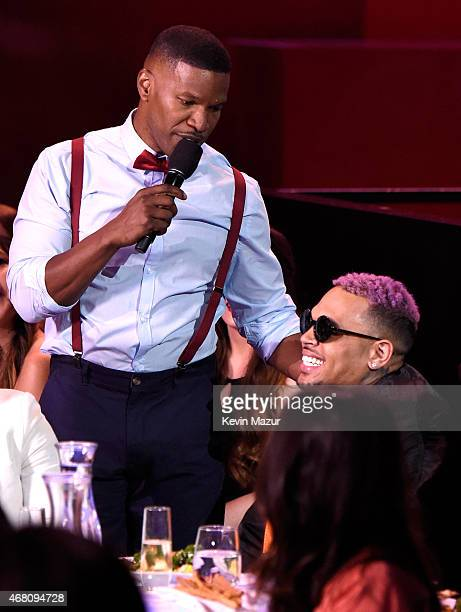 Host Jaime Foxx and singer Chris Brown in the audience during the 2015 iHeartRadio Music Awards which broadcasted live on NBC from The Shrine...