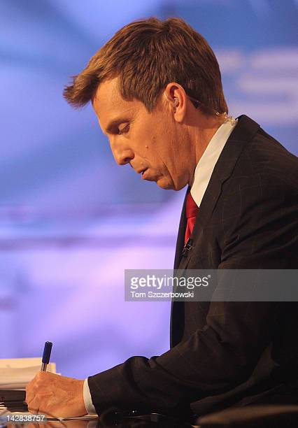 TSN host James Duthie prepares to go on air during the NHL Draft Lottery on April 10 2012 at the TSN Studios in Toronto Ontario Canada