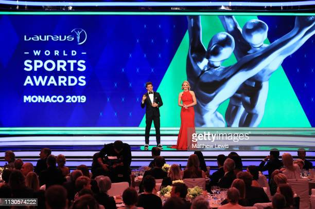 Host James Marsden talks to co host Amanda Davies on stage during the 2019 Laureus World Sports Awards on February 18 2019 in Monaco Monaco