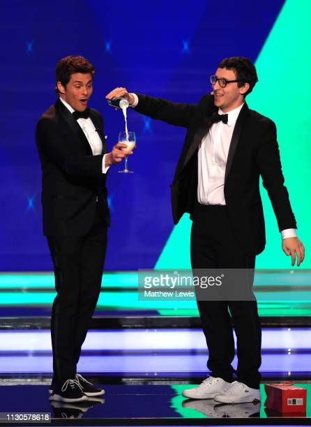 Host James Marsden with magician Julius Dein on stage during the 2019 Laureus World Sports Awards on February 18 2019 in Monaco Monaco