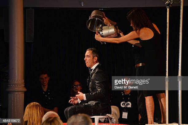 Host James Nesbitt takes the ALS Ice Bucket Challenge at the GQ Men Of The Year awards in association with Hugo Boss at The Royal Opera House on...