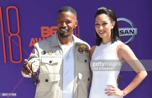 Host Jamie Foxx poses with his daughter Corinne Foxx upon arrival for the BET Awards at Microsoft Theatre in Los Angeles California on June 24 2018