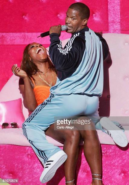 Host Jamie Foxx serenades tennis player Serena Williams with an original song called Tennis Ball on stage at the 12th Annual ESPY Awards held at the...