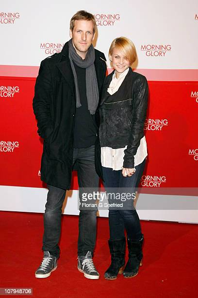 TV host Jan Hahn and girlfriend tv host Mirjam Weichselbraun attend the Premiere of 'Morning Glory' at CineStar on January 9 2011 in Berlin Germany