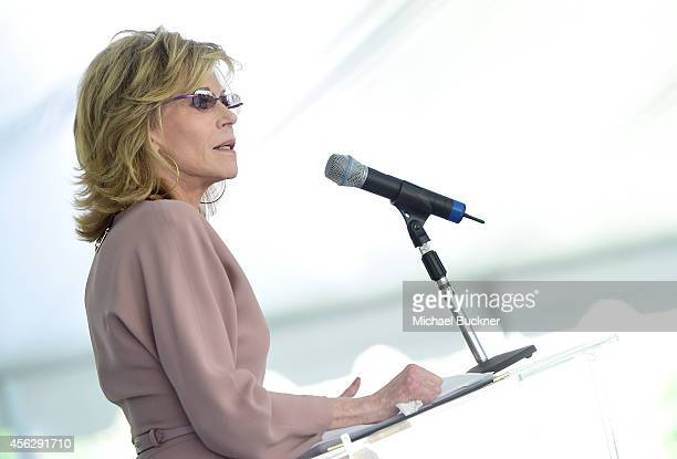Host Jane Fonda speaks onstage at The Rape Foundation's Annual Brunch at Greenacres on September 28 2014 in Beverly Hills California