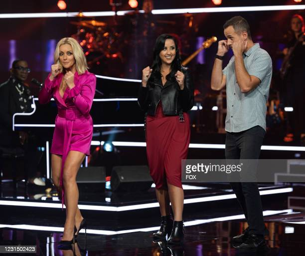 Host jane Krakowski with contestants Amber and Marshall in the Episode 9 / Episode 10 two-hour season finale episode of NAME THAT TUNE airing...