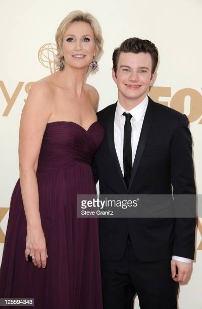 Host Jane Lynch and actor Chris Colfer arrive to the 63rd Primetime Emmy Awards at the Nokia Theatre LA Live on September 18 2011 in Los Angeles...