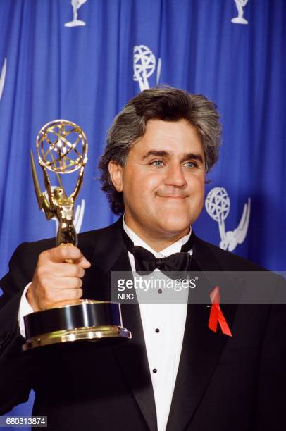 Host Jay Leno Posing for a portrait with Emmy Award