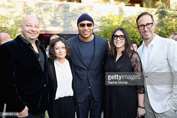 Host Jeff Ross Sara Gilbert LL Cool J Honoree Stacey Sher and Richard Weitz attended the 17th Annual Chrysalis Butterfly Ball in Los Angeles CA on...