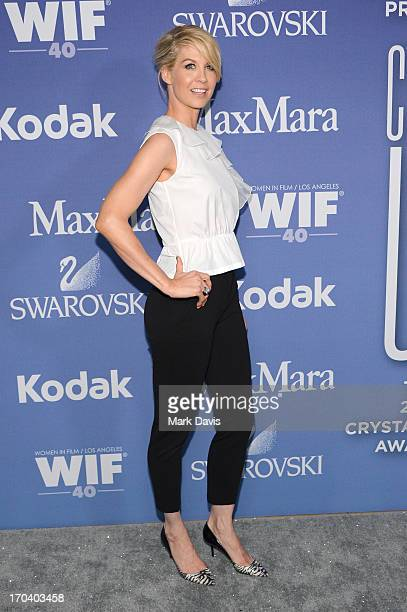 Host Jenna Elfman attends Women In Film's 2013 Crystal Lucy Awards at The Beverly Hilton Hotel on June 12 2013 in Beverly Hills California