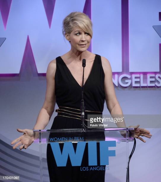 Host Jenna Elfman speaks onstage during Women In Film's 2013 Crystal Lucy Awards at The Beverly Hilton Hotel on June 12 2013 in Beverly Hills...