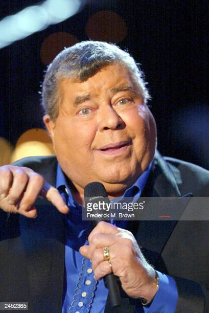Host Jerry Lewis performs during the Jerry Lewis Muscular Dystrophy Telethon at CBS Television Studios on August 31 2003 in Los Angeles California
