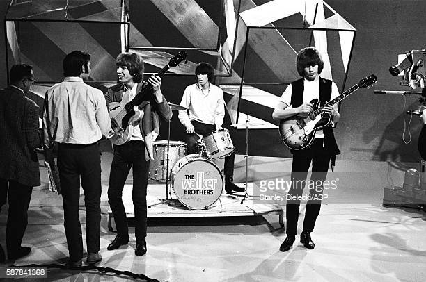 Host Jim Dale talks to The Walker Brothers on the set of TV show Thank Your Lucky Stars United Kingdom August 1965 LR Jim Dale Scott Walker Gary...