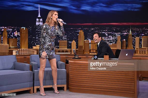 Host Jimmy Fallon looks on as singer Celine Dion performs on 'The Tonight Show Starring Jimmy Fallon' at Rockefeller Center on July 21 2016 in New...