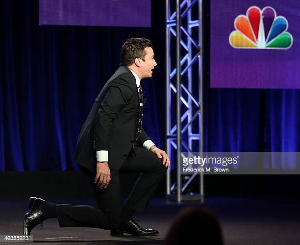 Host Jimmy Fallon of the television show 'The Tonight Show Starring Jimmy Fallon' kneels during the NBC portion of the 2014 Television Critics...