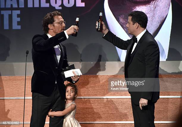TV host Jimmy Kimmel presents the American Cinematheque Award to honoree Matthew McConaughey with Vida Alves McConaughey onstage at the 28th American...