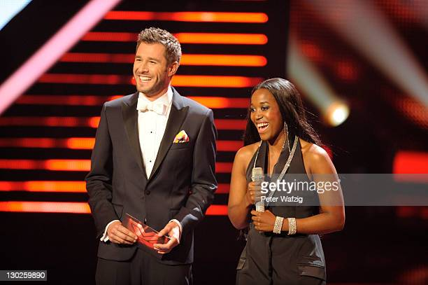 Host Jochen Schropp and Gladys Mwachiti during 'The X Factor Live' TVShow on October 25 2011 in Cologne Germany