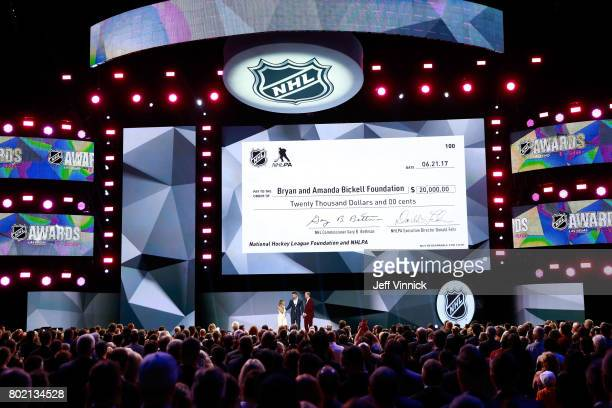 Host Joe Manganiello former NHL player Bryan Bickell Bickell's wife Amanda speak onstage during the 2017 NHL Awards Expansion Draft at TMobile Arena...