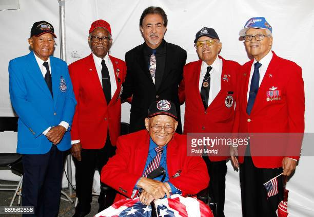 Host Joe Mantegna poses for a photo with members of The Tuskegee Airmen backstage at PBS' 2017 National Memorial Day Concert at US Capitol West Lawn...
